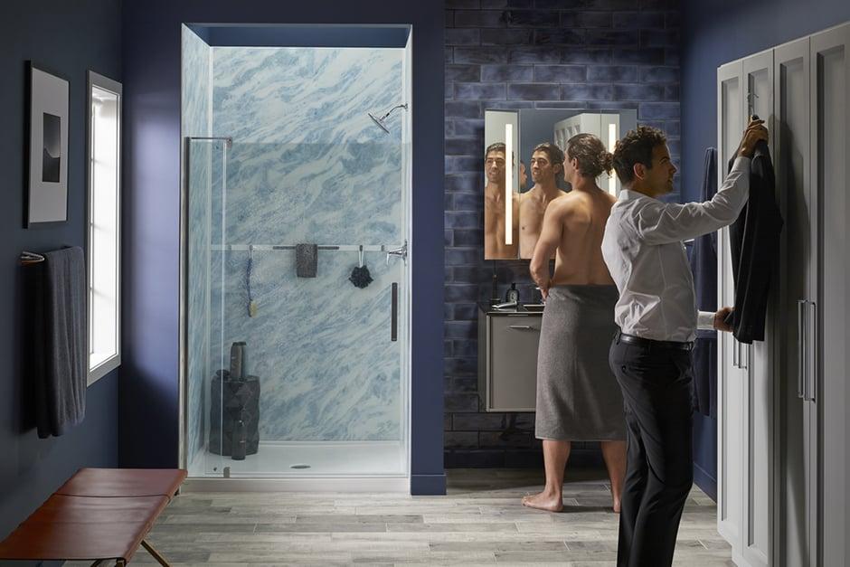 couple in bluette shower by kohler luxstone'
