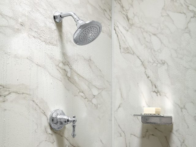 A traditional showerhead and floating shelf against CrossCut dune.