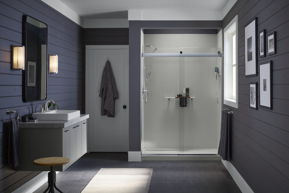A modern farmhouse style shower with glass shower door.
