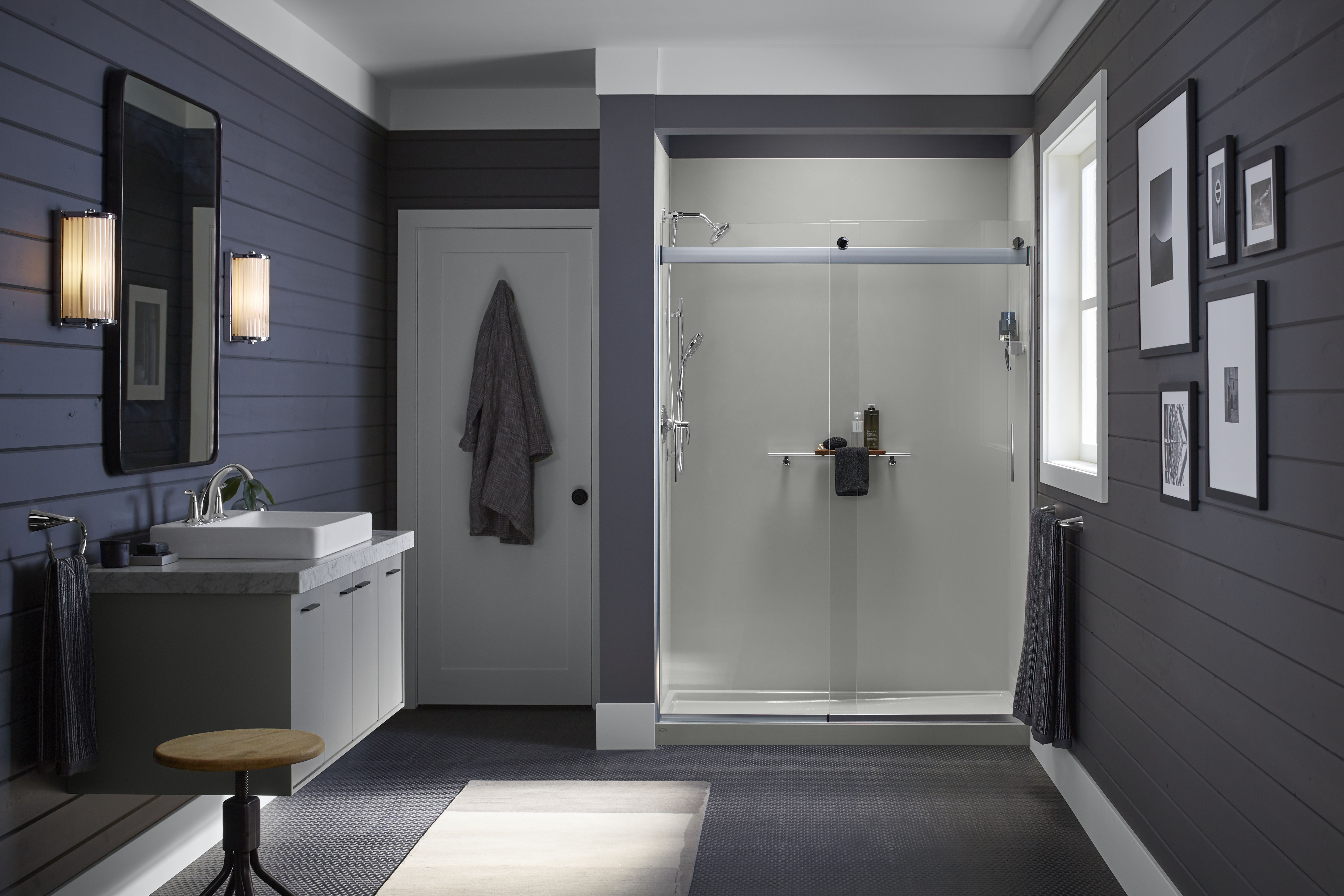 A modern farmhouse style shower with glass shower door.'