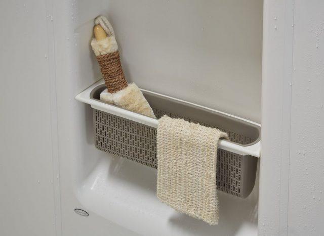 Close up view of a storage basket inside a Kohler LuxStone Shower