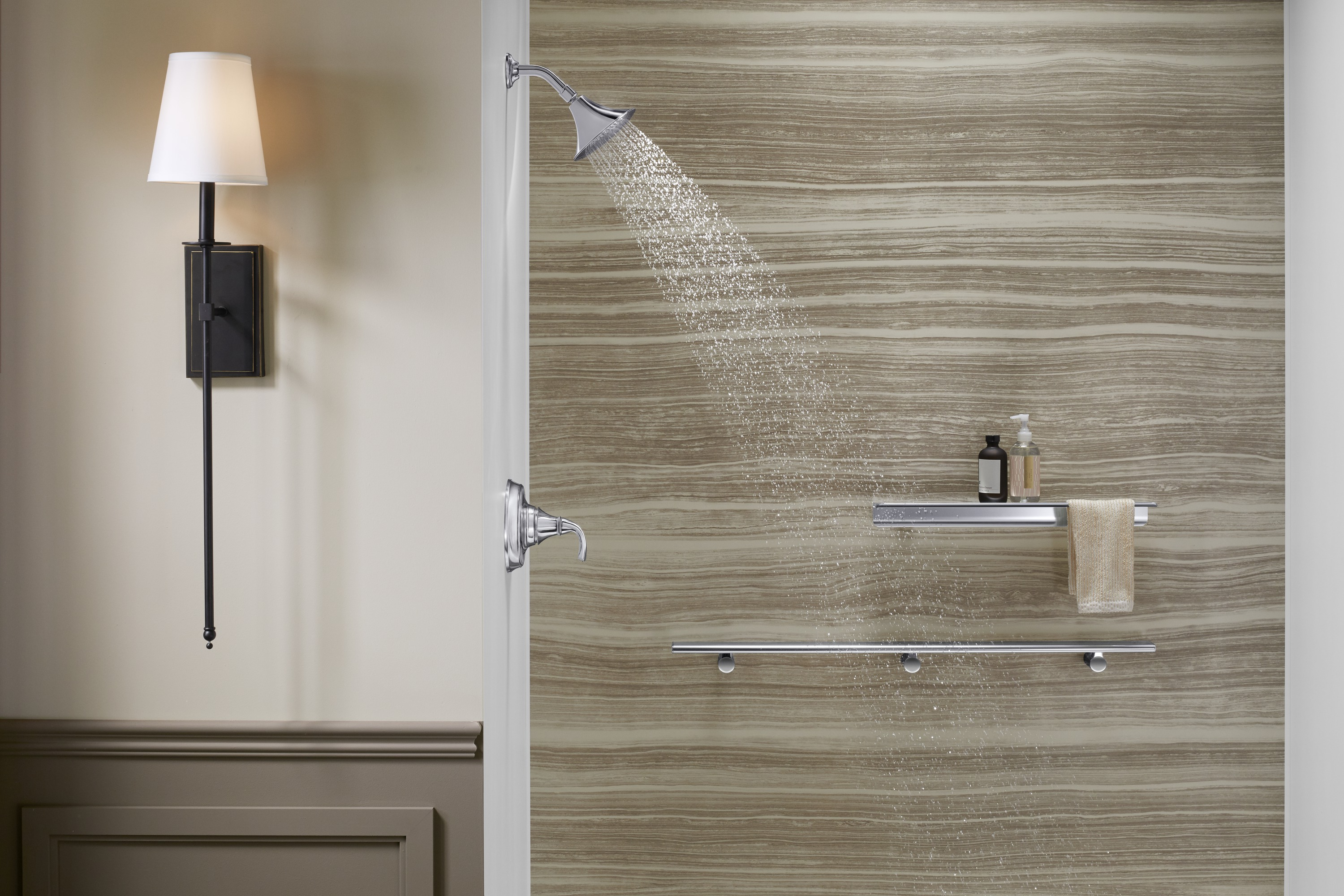 Image of a walk in shower with water spraying out of its shower head
