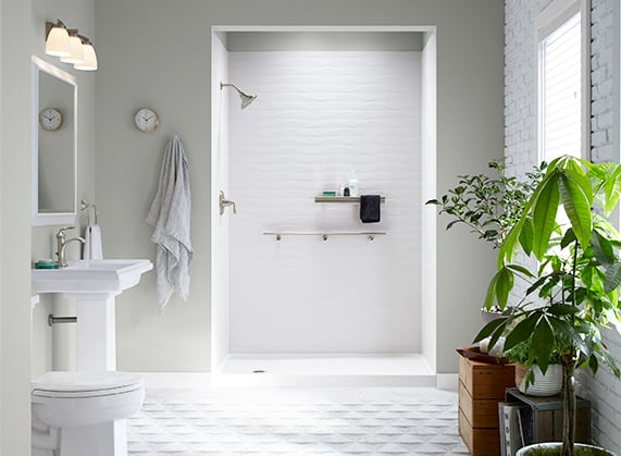 Urban bathroom with white brick and shower.