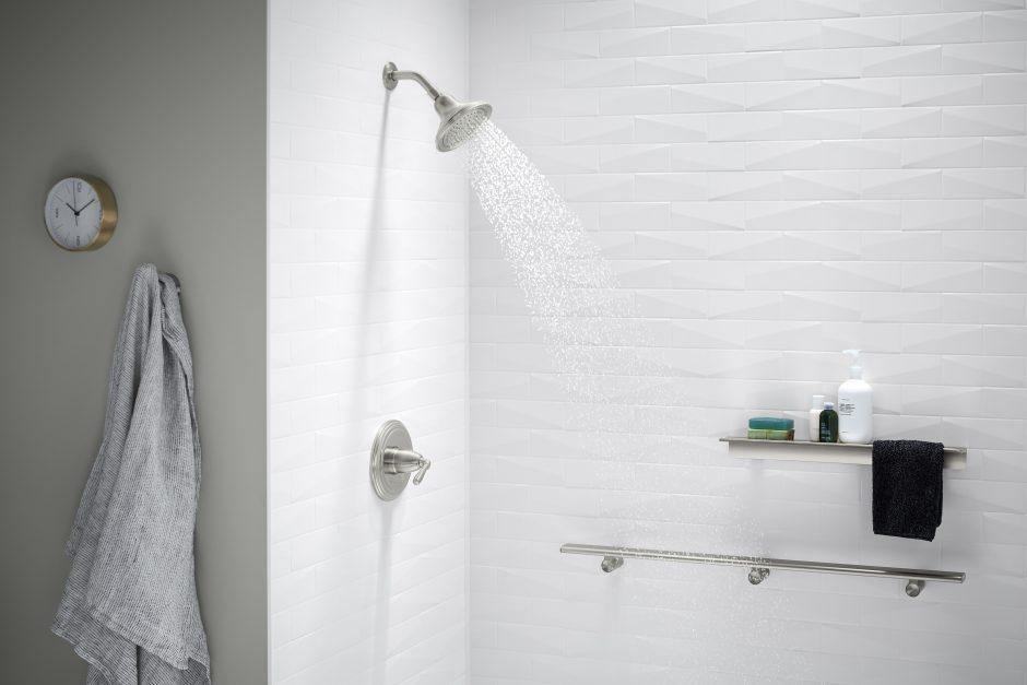 White brick shower with shower head running