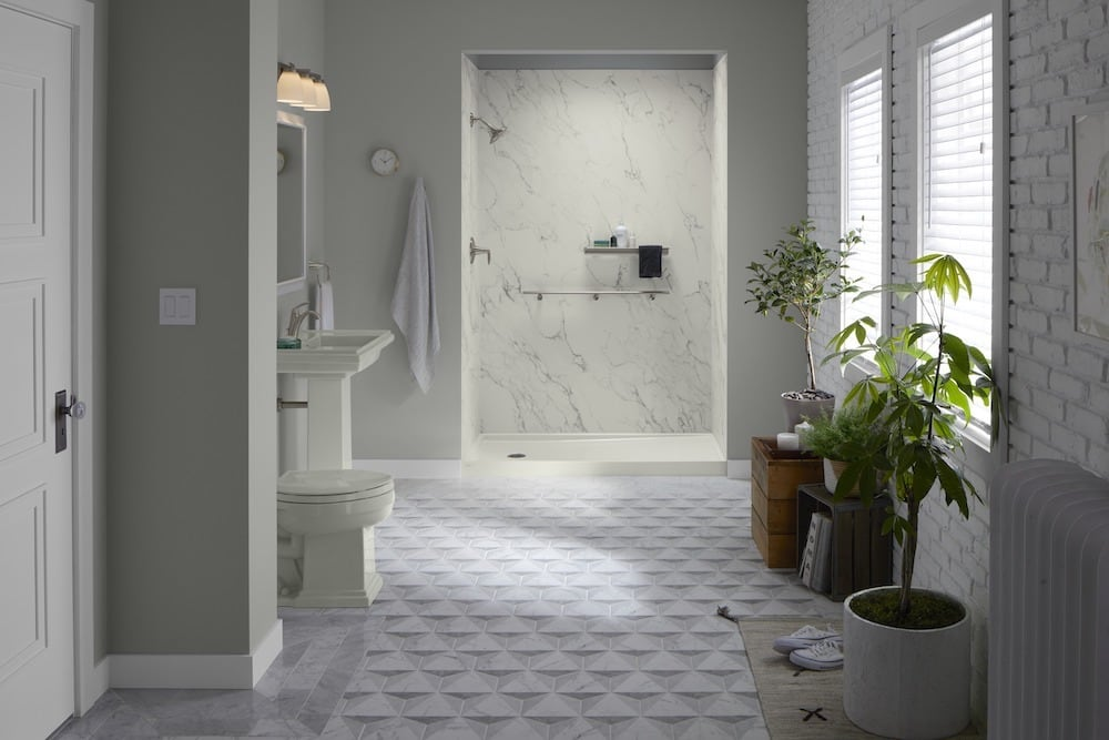Neutral bathroom with white brick shower'