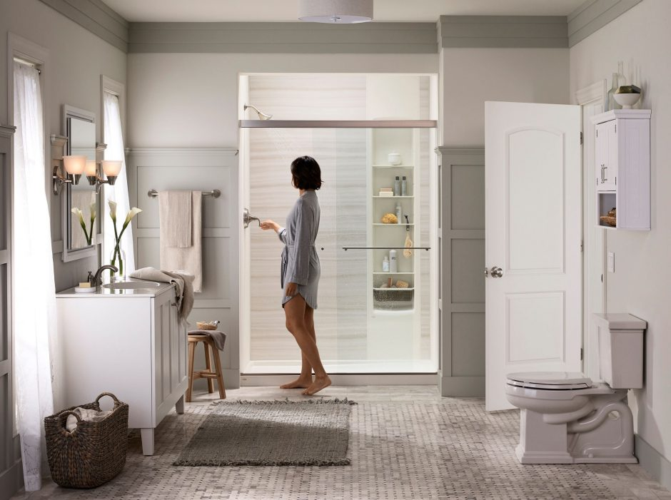 Woman turning on her LuxStone shower.