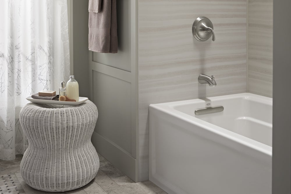 tub with bath accessories on a stool'