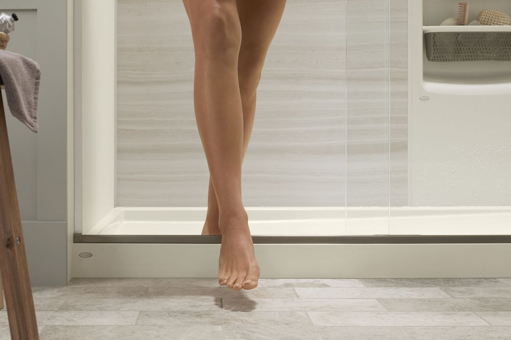 woman stepping out of the shower