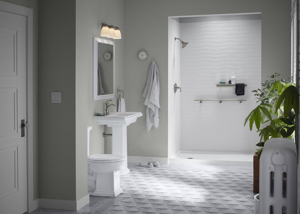 shower with white brick walls and silver shelf