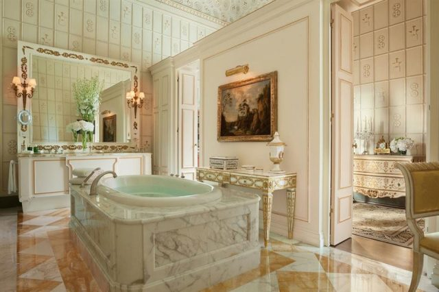 huge gold and peach bathroom