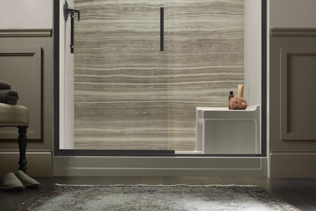 Glass shower door with oil-rubbed bronze hardware