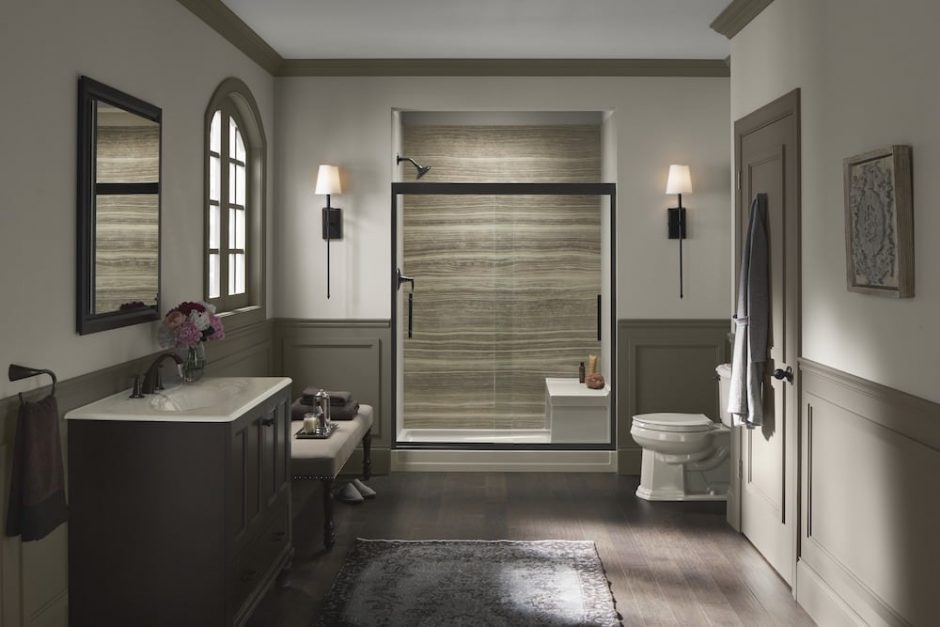 Walk-in shower with brown walls and dark hardware
