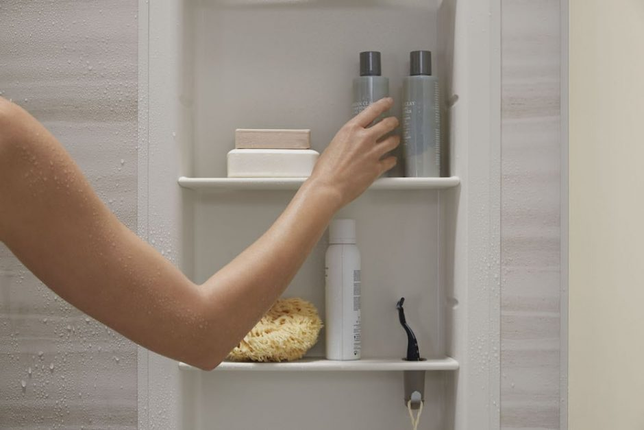 woman adjust shower products