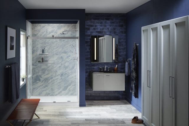 A bathroom with a Kohler LuxStone Shower that has blue and white colored Bluette shower walls