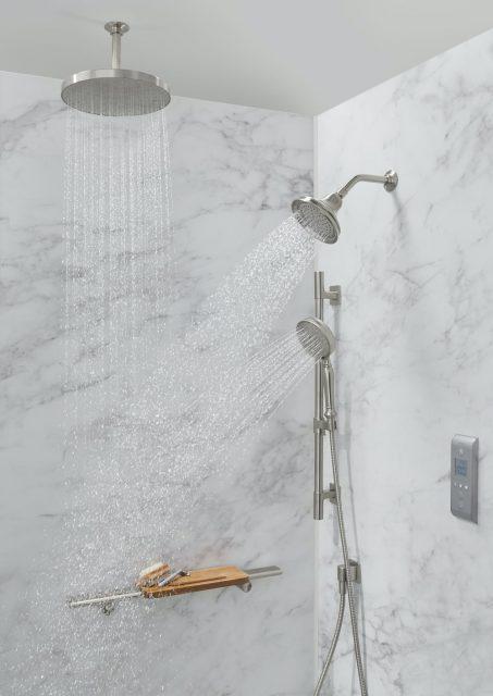 Calacatta shower walls featuring rainhead and handshower