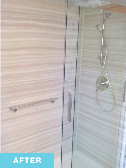 Inside of walk-in shower with striped walls