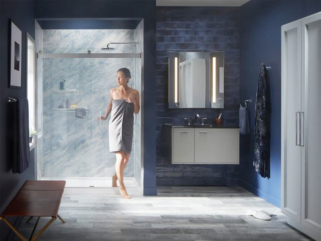 Woman walking out of shower in towel