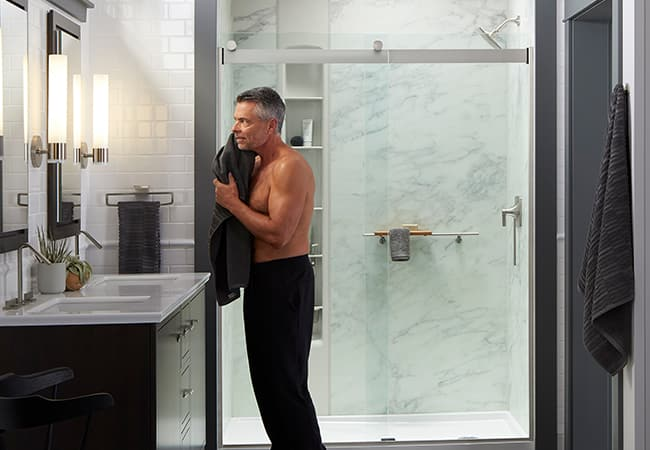 Image of man drying off after shower