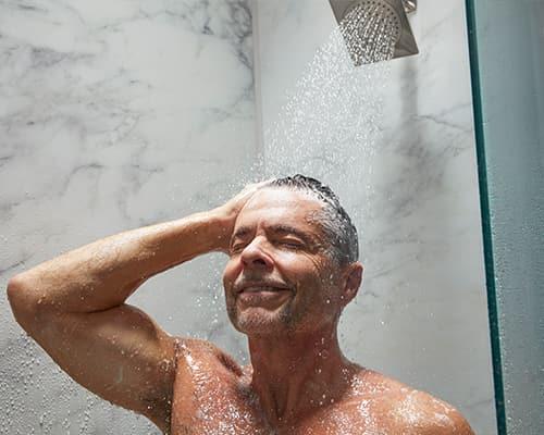 Image of man enjoying LuxStone Shower