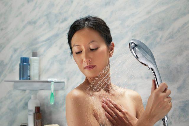 woman using handshower