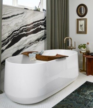 Ceric freestanding bath with hanging wall art.