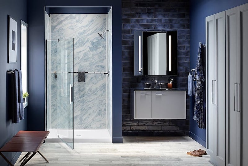 Blue bathroom with glass shower door open
