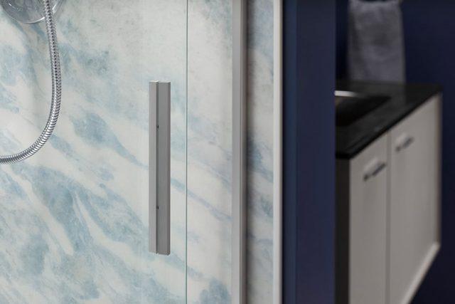 Vertical handle for glass shower door