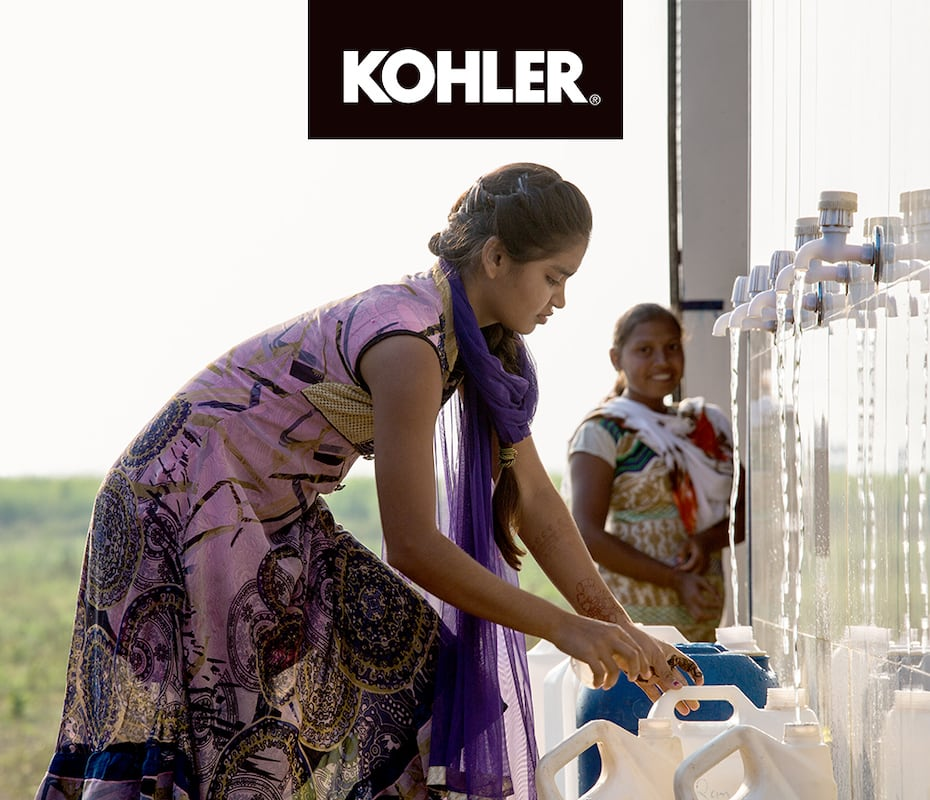 Girl getting water from KOHLER water station'
