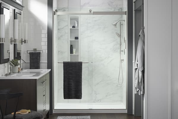 LuxStone shower with grey walls and glass door