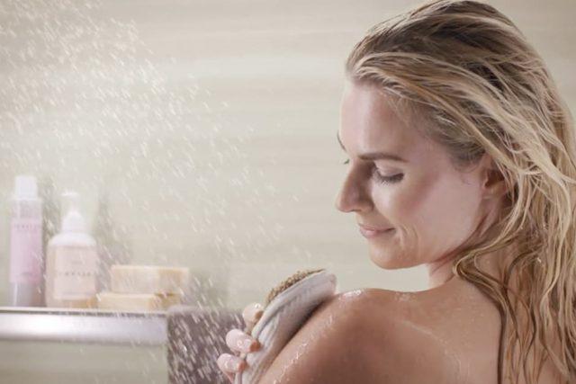 Woman dry brushing skin