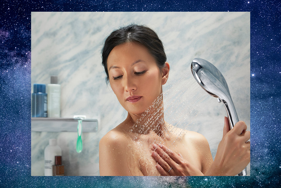 Woman using handshower with galaxy background'