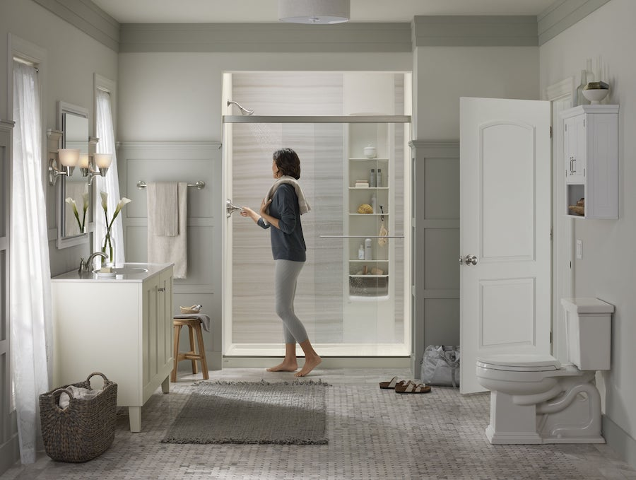 Woman standing outside of shower