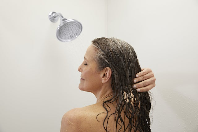 Person standing in shower