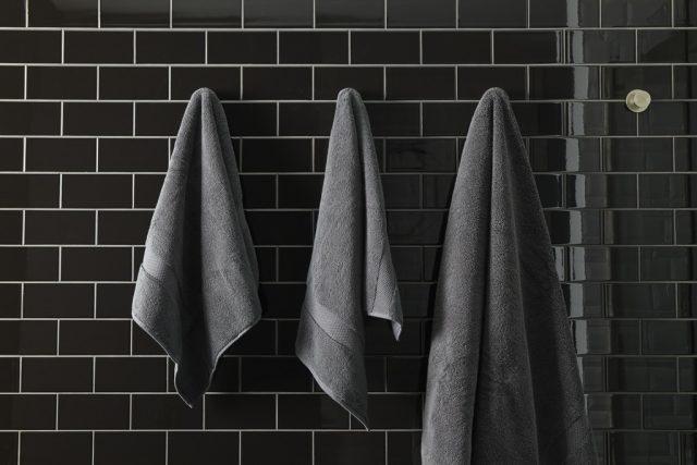towels hanging on bathroom wall