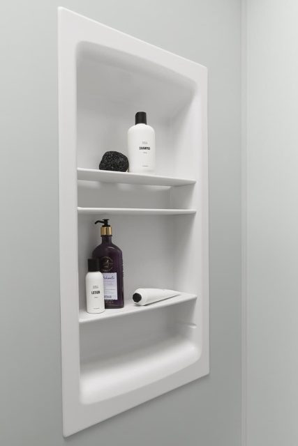 shower shelving with bottles and accessories