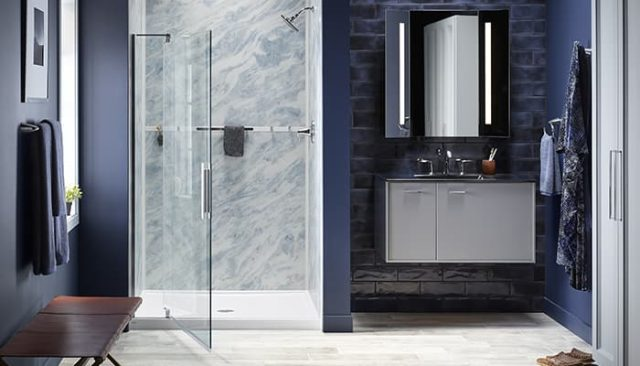 blue shower with pivoting glass door