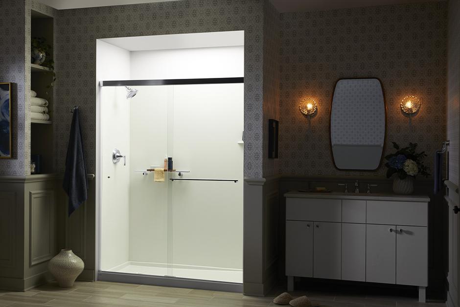 Bathroom at night with illuminated walk-in shower.'