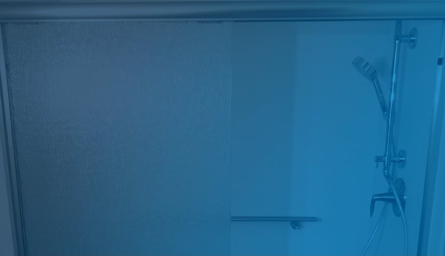 Close up view of a Kohler Luxstone Shower through a blue color filter
