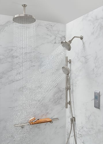 A Kohler LuxStone shower with overhead faucets and a DTV system